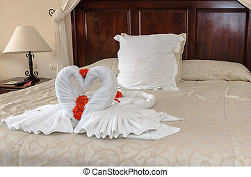 towels swans - decorative two nice towels swans on bed sheet...