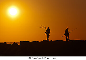 sunset - Two men walking with rods at sunset