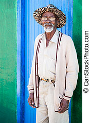 Old man - A old man standing in front of his colorful shack