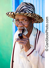 Smoking grandpa - Old man smoking his pipe