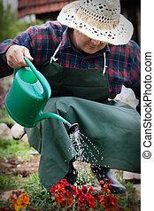 Spring garden concept Male is doing garden work in herb...