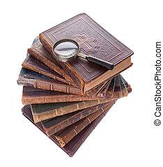 stack antique books and  magnifier