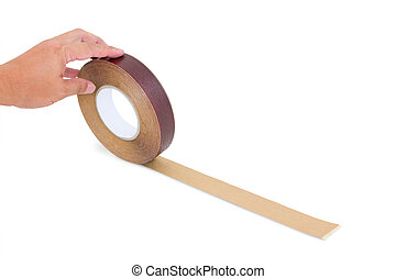 hand holding wood tape isolated with clipping path