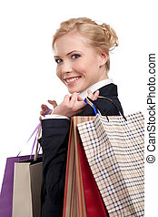 Young business woman in a black suit holding shopping bags