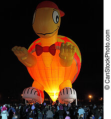 Happening glowing balloons in the night sky - A huge balloon...