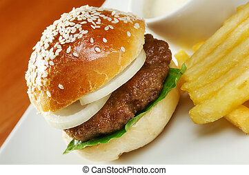 Hamburger with french fries closeup