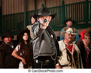 1800's western sheriff with gun drawn at point blank range