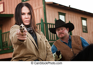 Old West Partners Aim Guns - Pretty woman and partner aim...