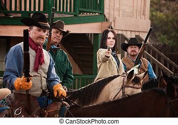 Cowgirl Points Her Pistol - Old American west woman with...