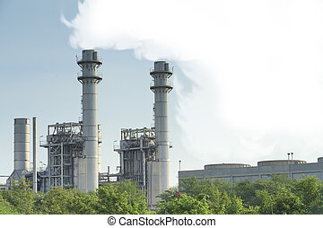 Natural gas factory with blue sky and steam.
