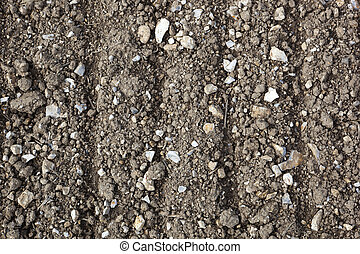 stony soil background - a background image of chalky...