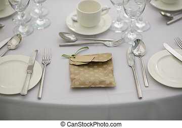 dinner setting at a wedding
