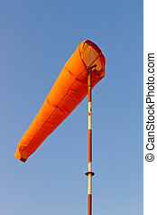 Wind sock against blue sky