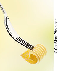 Butter curl on a fork - Single butter curl on a metal fork