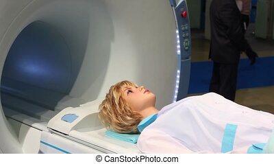 Womans mannequin lay on tomograph at medical exhibition