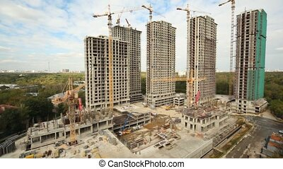 Building of housing estate from several high apartment...