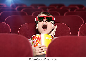 Emotional girl at the 3D cinema