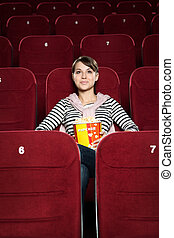 Young woman watching a movie