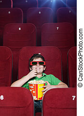 Smiling boy in the movie theatre