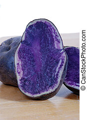 Blue Potatoes - Close up of blue potatoes, sliced in half