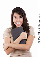 Young female hug her book