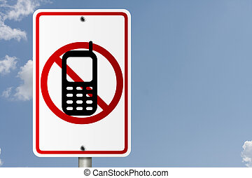 No Cell Phones while driving - An American road sign with...