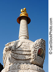 White tower in a Tibetan lamasery - Historic white stupa...
