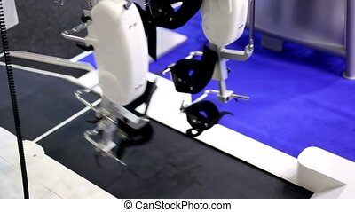Robotic prosthetic legs moves above working racetrack