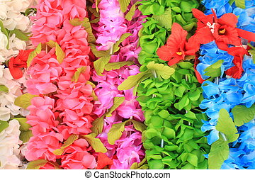 Hawaiian leis - Various colors of Hawaiian leis hanging in...