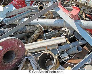 pipes and rusty irons in a landfill of iron