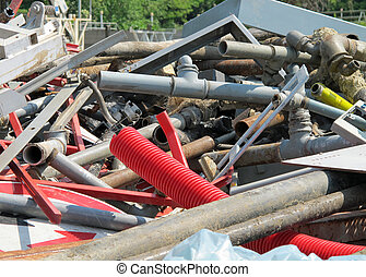 pipes and irons in a landfill of old iron