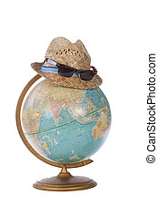 Travel tourist summer vacation - straw hat on antique globe