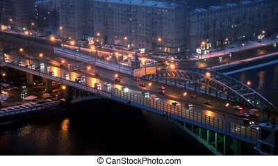 Street and bridge traffic on third transport ring at winter night in Moscow