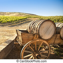Grape Vineyard with Old Barrel Carriage Wagon