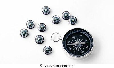 Nine small black plastic compasses and one big isolated on...