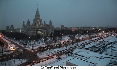 Main building of Moscow State University at winter evening...