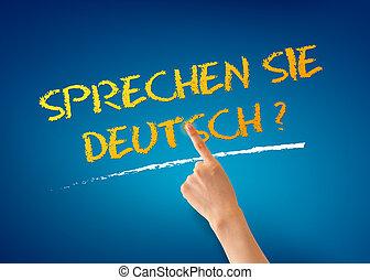 Sprechen Sie Deutsch - Hand pointing at a Sprechen Sie...