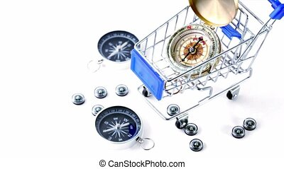 Nine small black plastic compasses in little shopping cart