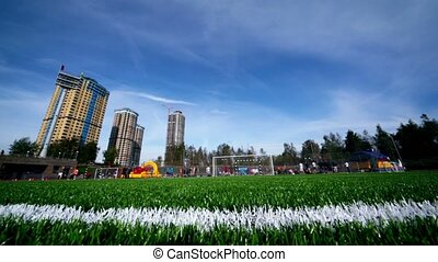 People involved in sports, stadium at autumn sunny day