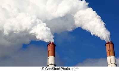White smoke comes from two tubes against sky - White smoke...