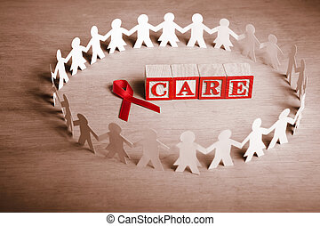 AIDS care - Red ribbon with word 'Care' surrounded by female...