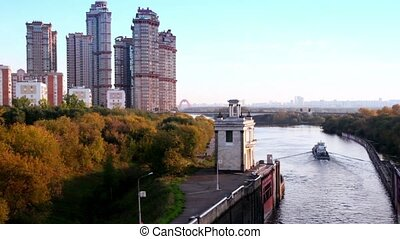 Ship sail down the Moscow Canal at sunny autumn evening in...
