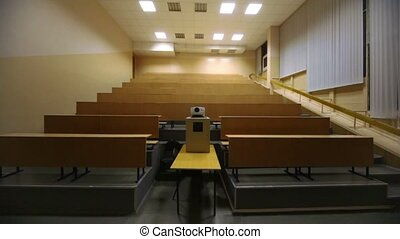 Light turned off, and then switched on, in empty lecture auditorium