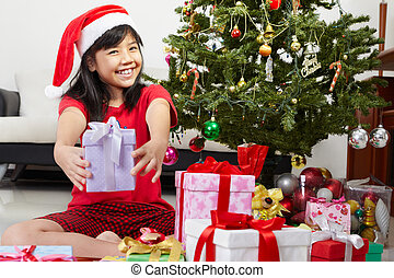 Little girl pointing Christmas present
