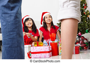 Christmas morning - Kids busy opening Christmas present...