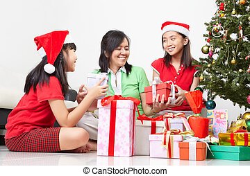 Exchanging present on Christmas - Mother and daughters...