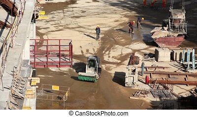 Several worker in action on construction site, special...