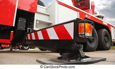 foot of support of fire-engine with light alarm system side...