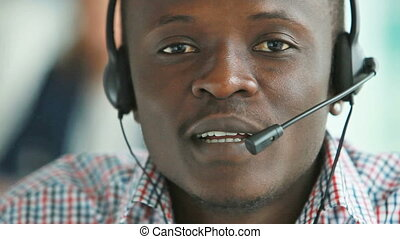 Support service - Close-up of African-American guy wearing...