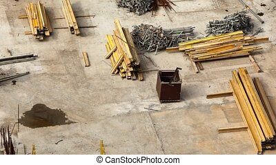 worker runs on building site among materials - worker in...